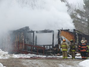 A home at 606 Middle Road in Dresden was fully involved with fire when firefighters arrived late Friday morning. DARCIE MOORE/THE TIMES RECORD