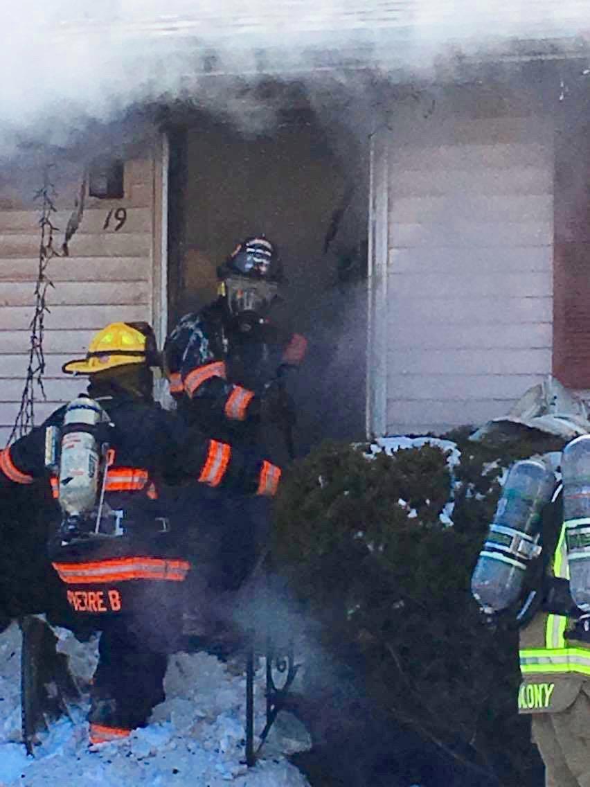 Firefighters attack a blaze at 19 Harmon Ave. in Old Orchard Beach Saturday evening. The home was heavily damaged and the family displaced. One family member was treated for burns but has since been released form hospital, COURTESY PHOTO/Perian Carpenter