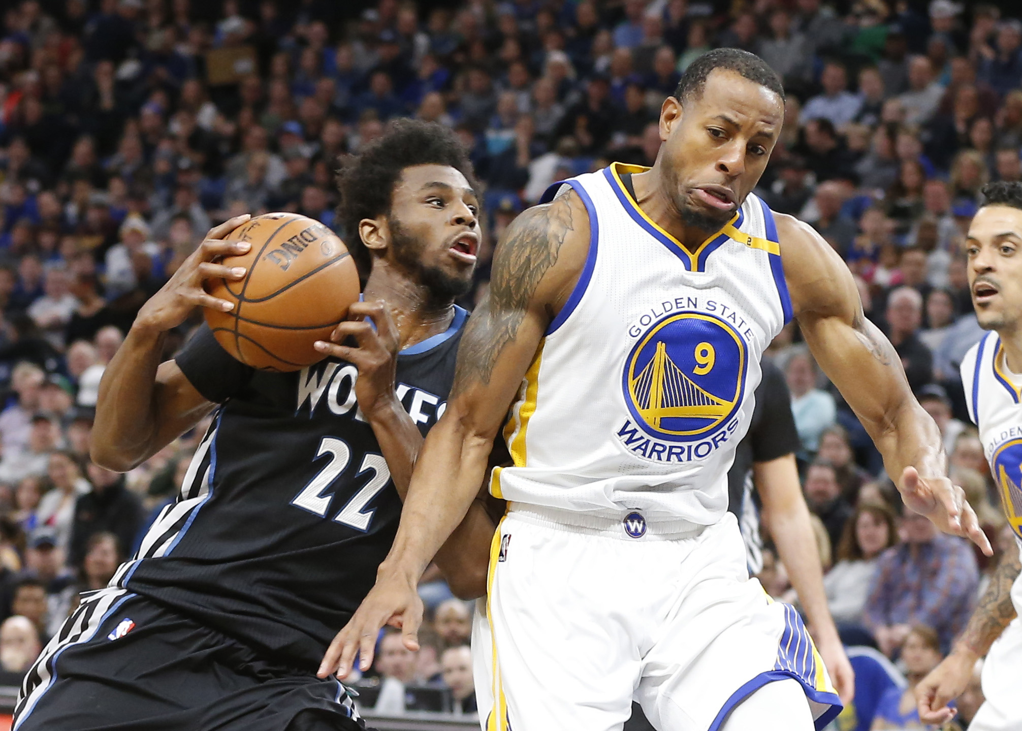 Minnesota Timberwolves' Andrew Wiggins, left, bumps into Golden State Warriors' Andre Iguodala as he drives during the first half of an NBA basketball game Friday, March 10, 2017, in Minneapolis.AP NEWSWIRE