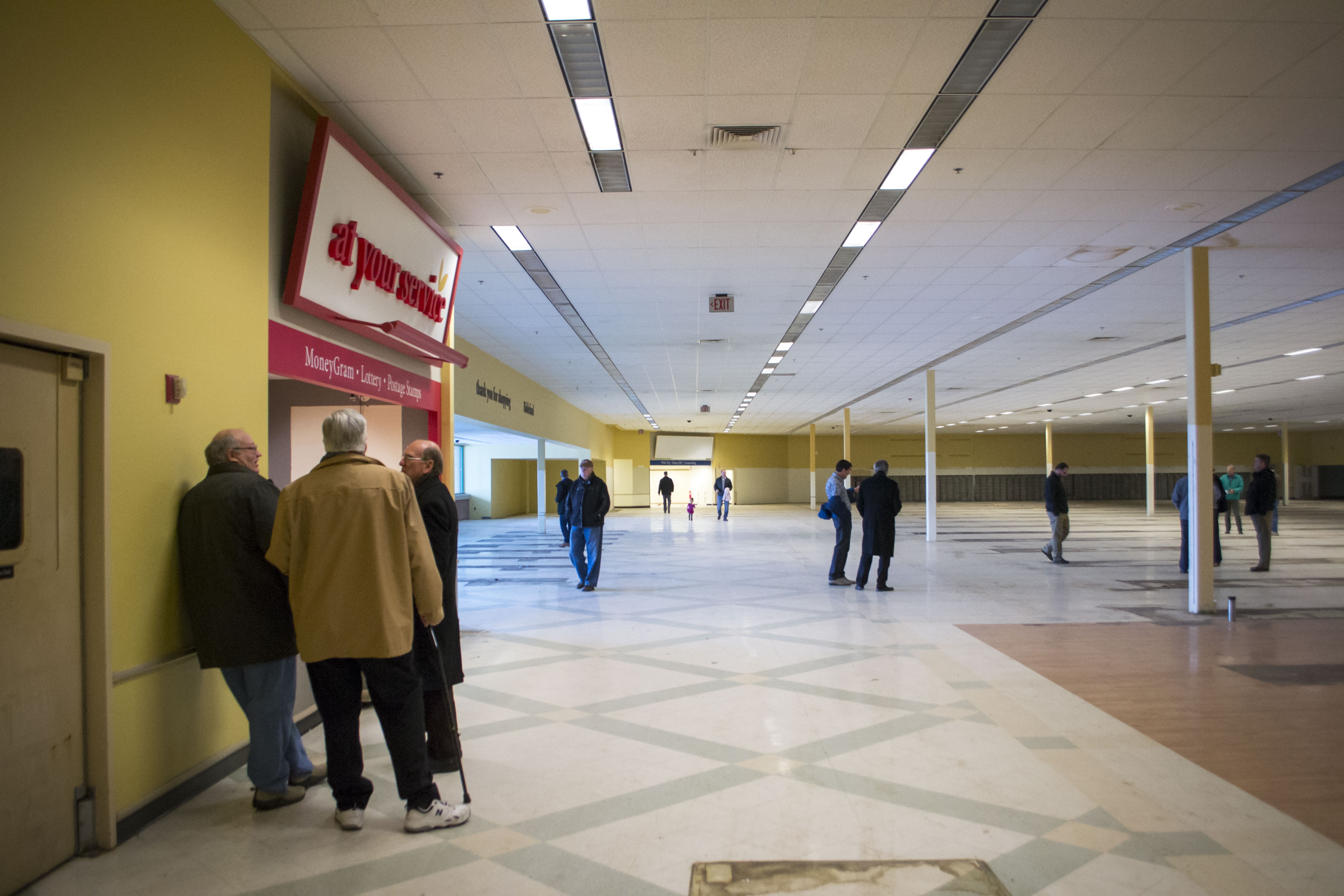Potential bidders explore the interior of the vacant Shaw's building in Biddeford prior to auction on Friday. The building has been vacant since July 4, 2015, when operations ceased due to competition from other stores in close proximity. ALAN BENNETT/Journal Tribune
