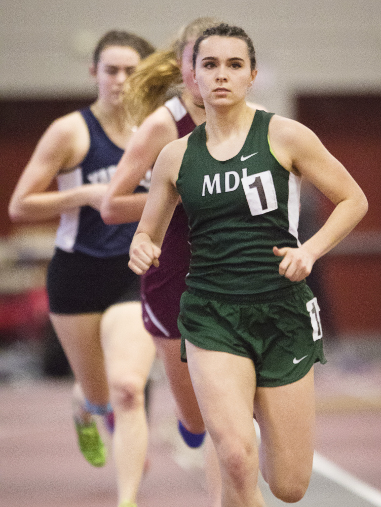 Mt. Desert Island's Tia Tardy leads the pack on her way to victory in the mile at the Class B indoor track state championships. Tardy also won the 800 and placed second in the 2-mile, then went on to finish second in the mile at the New England championships.