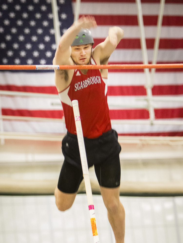 Scarborough's Sam Rusak clears the bar at 16 feet, 3 inches to set a pole vault state record at the Class A indoor track championships. Rusak also won the high jump and 200 meters as he swept all three of his events for the second straight year.