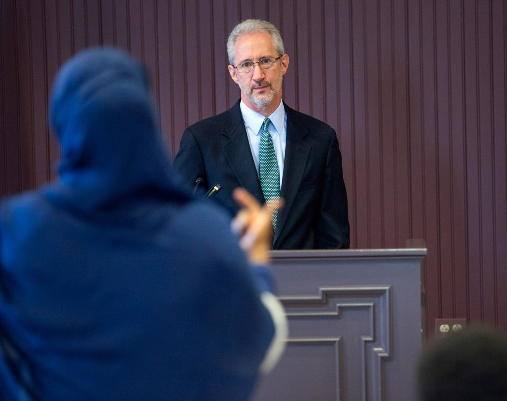 Stephen Schwartz, the U.S. ambassador to Somalia, listens to a woman's question while speaking with the public in Lewiston on Thursday. Schwartz fielded questions about the Somalian government, American foreign policy in Africa, and President Trump's executive order that would impose a 90-day ban on travelers from six Muslim-majority countries, including Somalia.