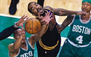 CLEVELAND guard JR Smith (5) battles for a rebound against Boston's guard Avery Bradley, left, during the first quarter of an NBA basketball game in Boston on Wednesday. At right is Celtics guard Isaiah Thomas. Boston was routed, 114-91.
