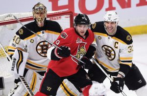 BOSTON BRUINS goalie Tuukka Rask, left, and Zdeno Chara defend against Ottawa's' Bobby Ryan during second period of Game 1 of an NHL Stanley Cup playoff series in Ottawa on Wednesday. Boston won, 2-1.