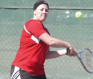 LISBON GIRLS TENNIS player Katherin George has her eyes on the ball during an MVC match last year. The Greyhounds open their regular season April 28.