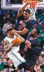 BOSTON CELTICS guard Isaiah Thomas, left, is covered by Chicago Bulls guard Dwyane Wade (3) and forward Cristiano Felicio (6) during the second quarter of a first-round NBA playoff basketball game in Boston on Tuesday. The Bulls won, 111-97.
