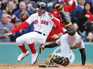 PITTSBURGH PIRATES catcher Chris Stewart, right, tags out Boston's Mookie Betts while trying to score on a hit by Hanley Ramirez during the eighth inning of a baseball game at Fenway Park in Boston on Thursday. The Red Sox won, 4-3.