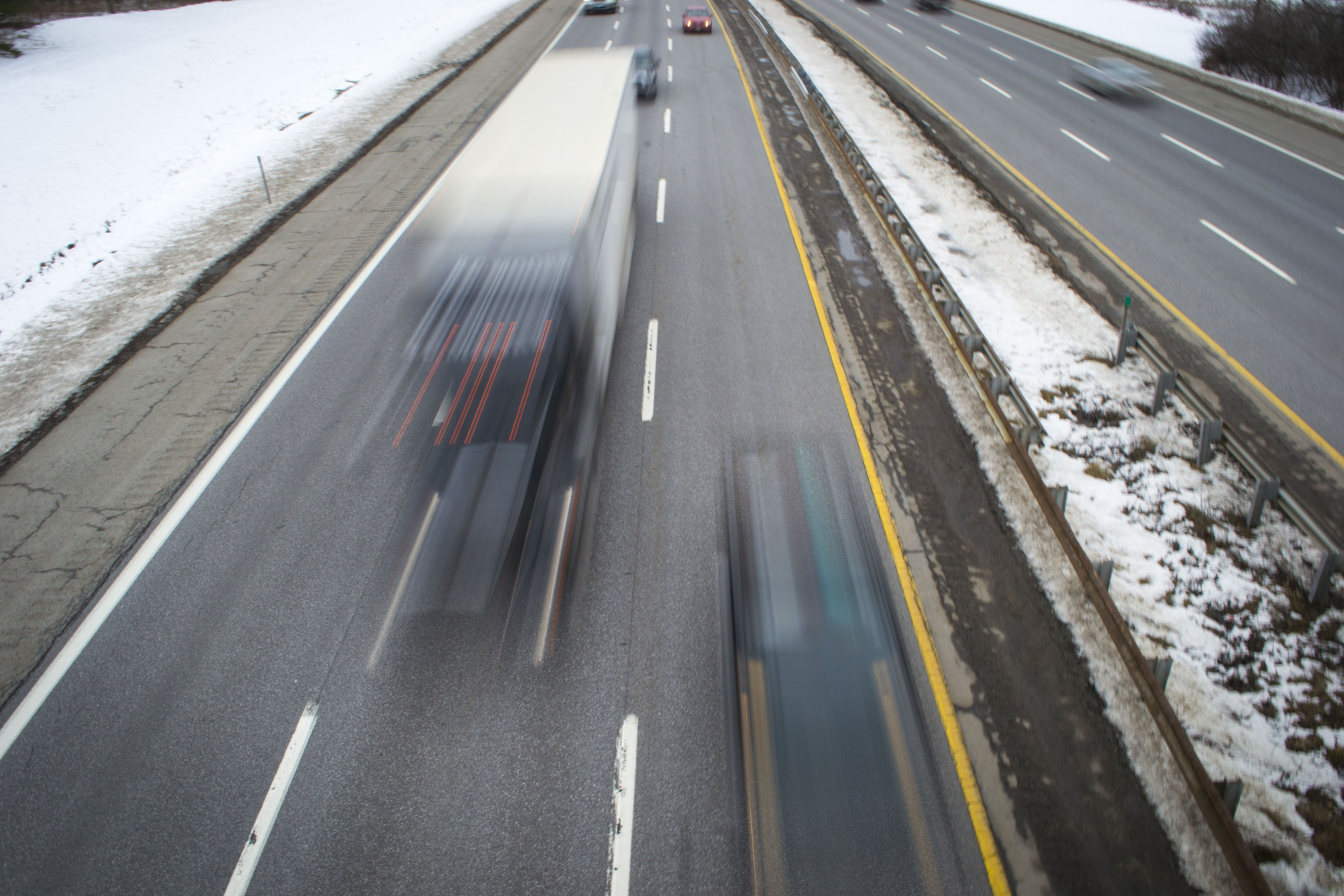 A tractor-trailer truck zooms down the Maine Turnpike in this photo taken from the South Street bridge in Biddeford in December. On Tuesday, Speaker of the Maine House, Sara Gideon, introduced new legislation to equip truckers with the tools to reduce human trafficking in Maine. ALAN BENNETT/Journal Tribune