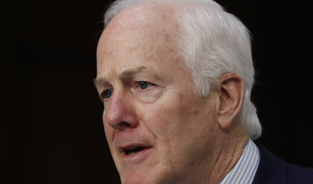 FILE - In this March 21, 2017 file photo, Senate Majority Whip John Cornyn of Texas speaks on Capitol Hill in Washington. Conservative senators are pushing to diminish insurance coverage requirements imposed by President Barack Obama's health care law as Senate Republicans try fashioning legislation overhauling the nation's health care system.  (AP Photo/Pablo Martinez Monsivais, File)