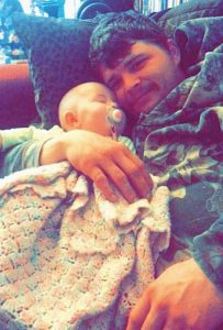STEPHEN WINES, 27, seen snuggling with his 7-month-old daughter.