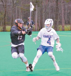 """MT. ARARAT HIGH SCHOOL lacrosse player Nick Canter (4) cuts back on the pressing Josh Dorr (15) of Brunswick during Monday's """"Battle of the Bridge"""" rivalry game at Bowdoin College. The Dragons used three late first-half goals to capture a 13-8 KVAC win."""