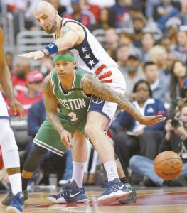 BOSTON CELTICS GUARD Isaiah Thomas (4) passes the ball against Washington Wizards center Marcin Gortat (13) during the first half in Game 4 of a second-round NBA basketball playoff series on Sunday in Washington.
