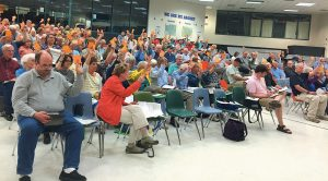 VOTERS AT THE Topsham town meeting on Wednesday approve an ordinance regarding vernal pools.