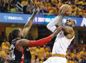 CLEVELAND'S LEBRON JAMES, right, drives to the basket against Toronto's Patrick Patterson (54) in the first half in Game 1 of a second-round NBA basketball playoff series on Monday in Cleveland.