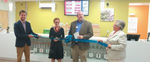 WELLNESS CONNECTION OF MAINE CEO Patricia Rosi and Southern Midcoast Maine Chamber Executive Director Cory King cut the ribbon at the grand opening of the Bath location on Centre Street last September.