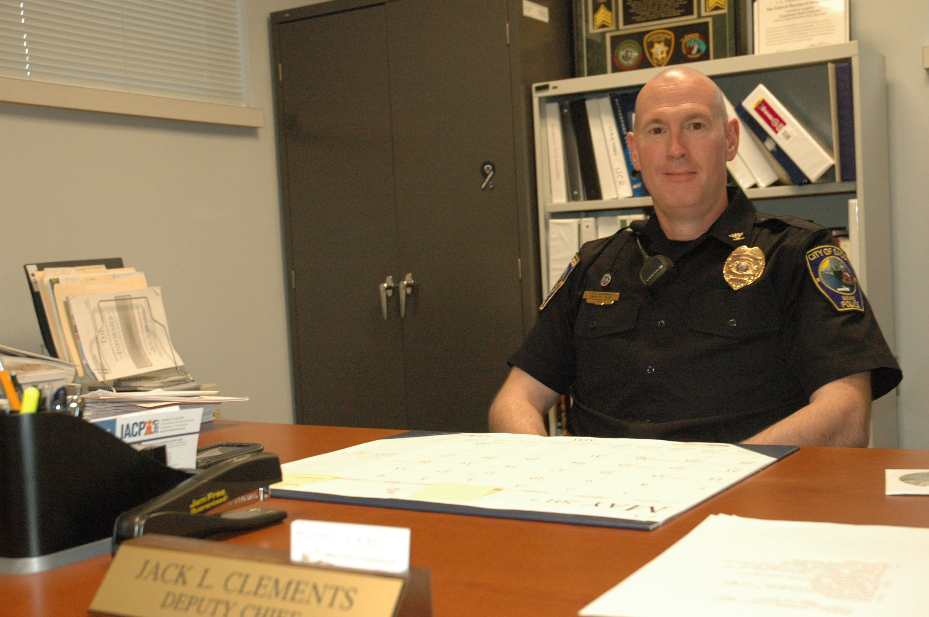 Saco Deputy Police Chief Jack Clements sits at his desk on Monday. LIZ GOTTHELF/Journal Tribune