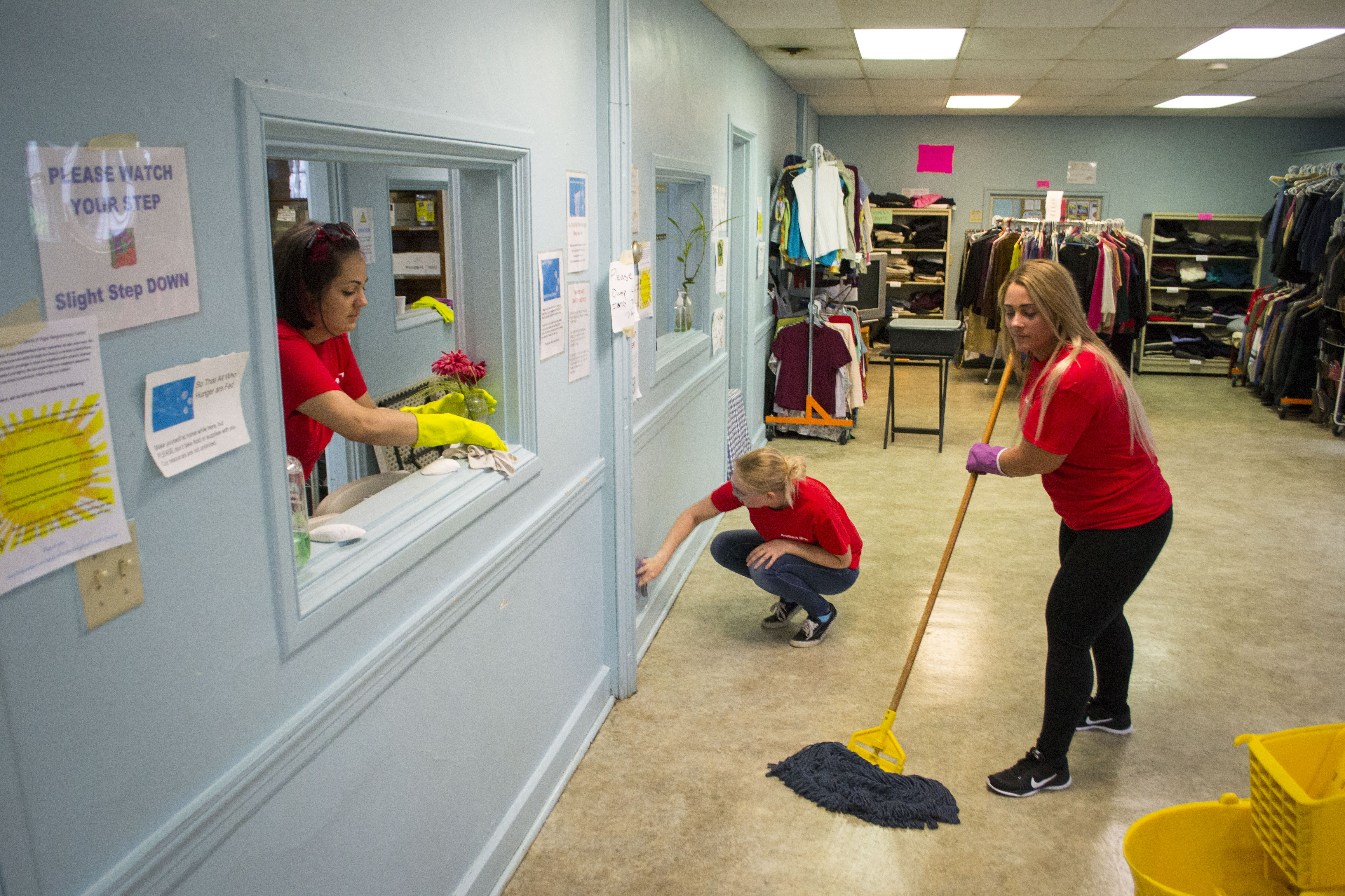 KeyBank employees from the Saco branch clean up the Seeds of Hope Neighborhood Center in Biddeford on Wednesday, as part of the bank's 27th annual
