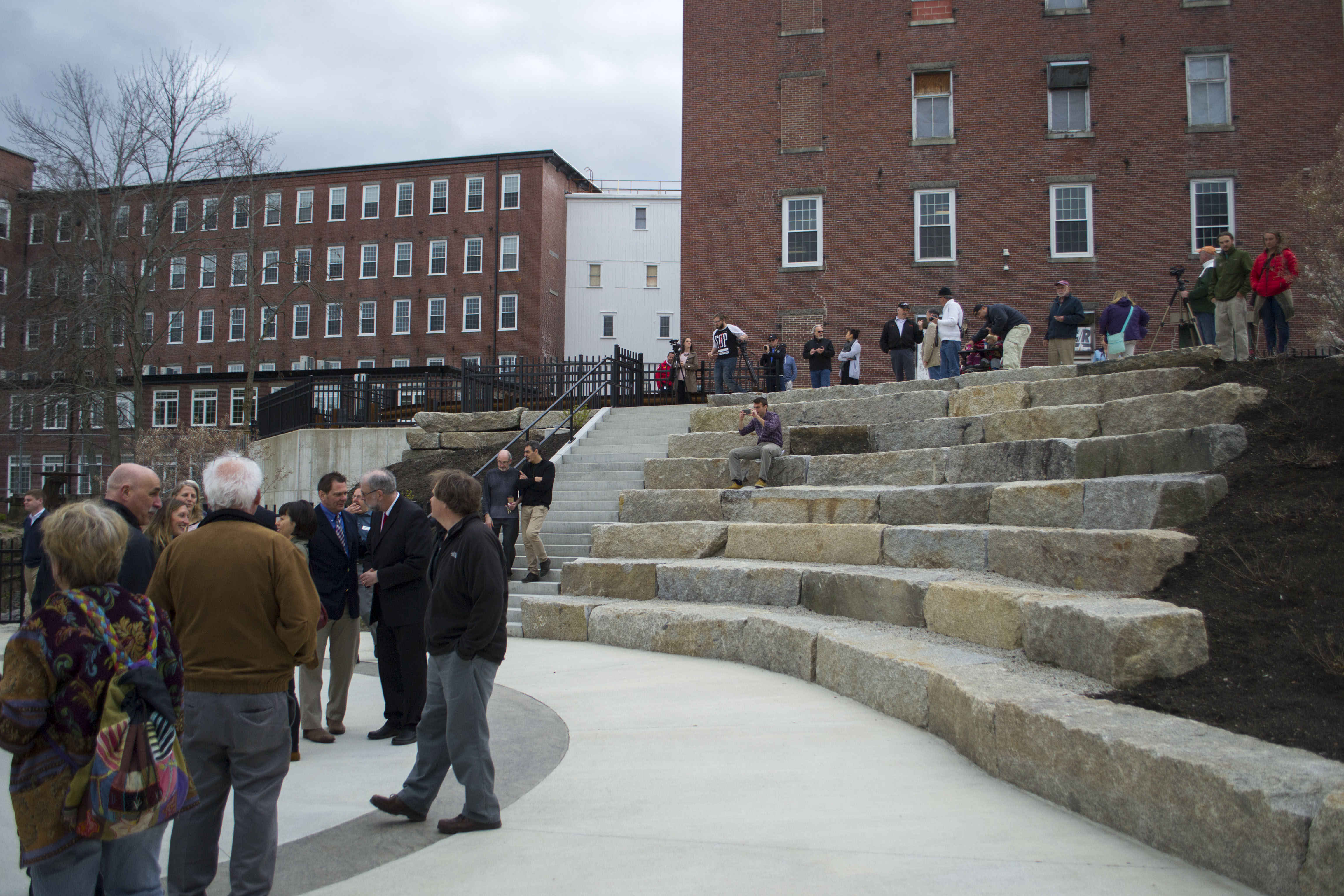 City residents, officials and members of the press gather at Laconia Plaza on Thursday. ALAN BENNETT/Journal Tribune