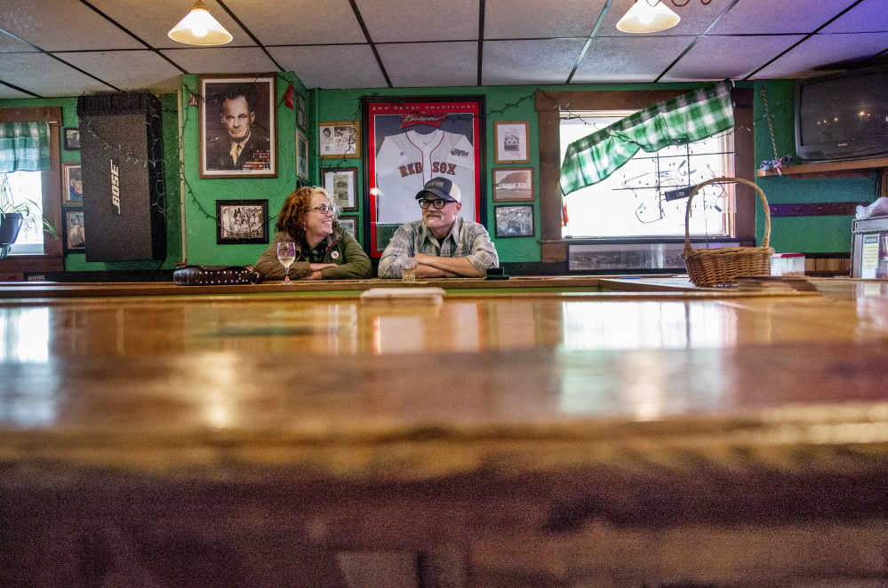 Matthew and Susan Robbins of South Portland talk at the Griffin Club last month. The owner of the business, which closed last week, hopes to reopen elsewhere in the city.