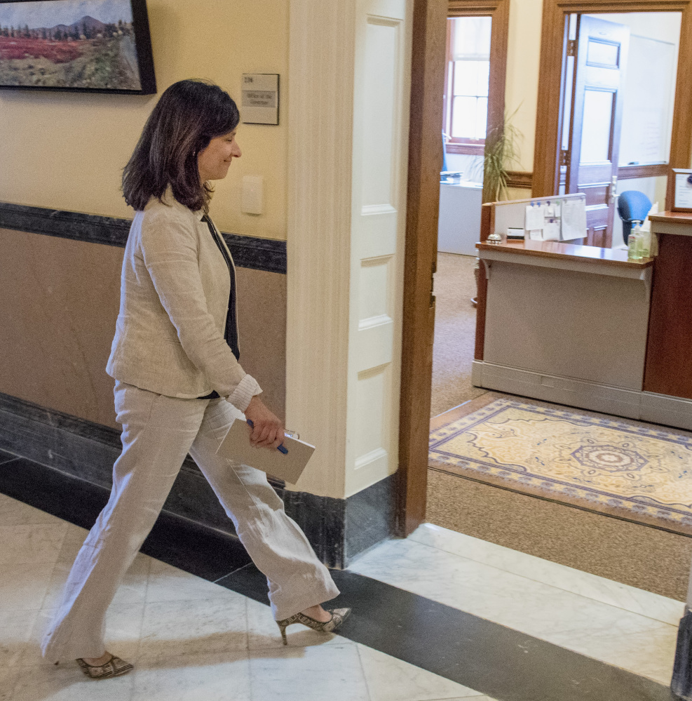 """House Speaker Sara Gideon enters Gov. LePage's office for a meeting on the budget impasse Tuesday. They spoke privately for about 45 minutes. Asked afterward how far apart the sides are, Gideon replied, """"The same."""""""