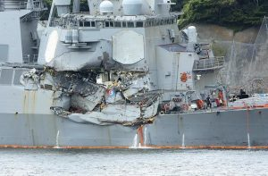 THE DAMAGED USS FITZGERALD, an Arleigh Burke-class vessel that was laid down by Bath Iron Works in February 1993 and launched in January of the following year, is seen at Yokosuka Naval Base, south of Tokyo, on Sunday. Navy divers found the bodies of missing sailors Sunday aboard the stricken USS Fitzgerald that collided with a container ship Saturday, the Navy said.