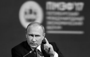 """RUSSIAN PRESIDENT VLADIMIR PUTIN gestures as he speaks at the St. Petersburg International Economic Forum in St. Petersburg, Russia, June 2. Putin is dismissing as """"a load of nonsense"""" the idea that Russia has damaging information on President Donald Trump and denies having any relationship with him, said Putin in an interview with NBC's """"Sunday Night with Megyn Kelly."""""""