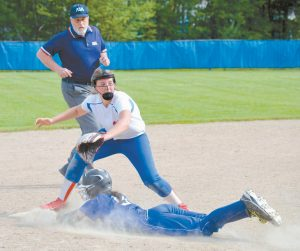 MORSE BASE RUNNER Dory Kulis slides safely into third base in front of Oak Hill third baseman Abby Nadeau during a Class B South quarterfinal in Wales on Thursday. Kulis and her Shipbuilders downed the Raiders, 9-4.