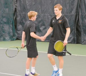 JACKSON GORDON (RIGHT) shakes hands with teammate Sawyer Nicholson after their No. 1 doubles match at the Class A North Regional Final at Maine Pines on Tuesday. The pair fell (6-3, 6-1) to Sam Frechette and Ben St. Laurent of Lewiston, which advanced to the Class A State Championship with a 3-2 win.