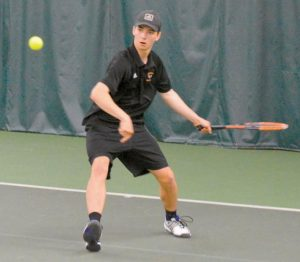 LUKE ESTABROOK eyes a forehand during his No. 3 singles match with Lewiston's Caden Smith. Smith won, 6-7, 6-3, 6-4.