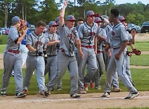 LISBON HIGH SCHOOL baseball players celebrate after earning a walk-off 4-3 Class C South win over Sacopee Valley on Thursday in Lisbon. Tyler Halls, front right, tied the game with a two-run single and scored the winning run on a wild pitch. The top-seeded Greyhounds host Traip Academy on Saturday at 1 p.m. in the semifinals.