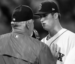 BOSTON RED SOX pitching coach Carl Willis, left, speaks with pitcher Drew Pomeranz after Pomeranz gave up runs to the Detroit Tigers in the first inning of a baseball game on Sunday in Boston. Pomeranz took the loss in Boston's 8-3 loss.