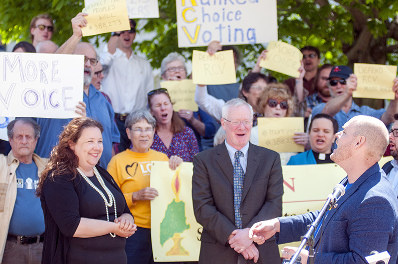 "Kyle Bailey of the Committee for Ranked Choice Voting, seen speaking at a rally in Augusta on June 1, said Friday night, ""We are waiting for the Secretary of State's Office to approve our (application) to begin collecting signatures"" for a people's veto."