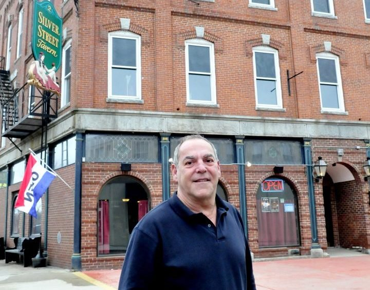 Charlie Giguere stands outside his Silver Street Tavern and renovated apartment building in April 2015 in Waterville. Gigure, president of the board of directors of Waterville Main Street, thinks the organization will not be funded by the city and will lose its standing as an organization.
