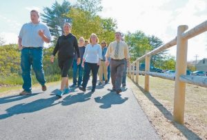SEVERAL AGENCIES and town officials walk a new trail that officially opened in Topsham Thursday afternoon.