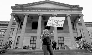 A WOMAN demonstrates outside the Montgomery County Courthouse Saturday in Norristown, Pennsylvania.