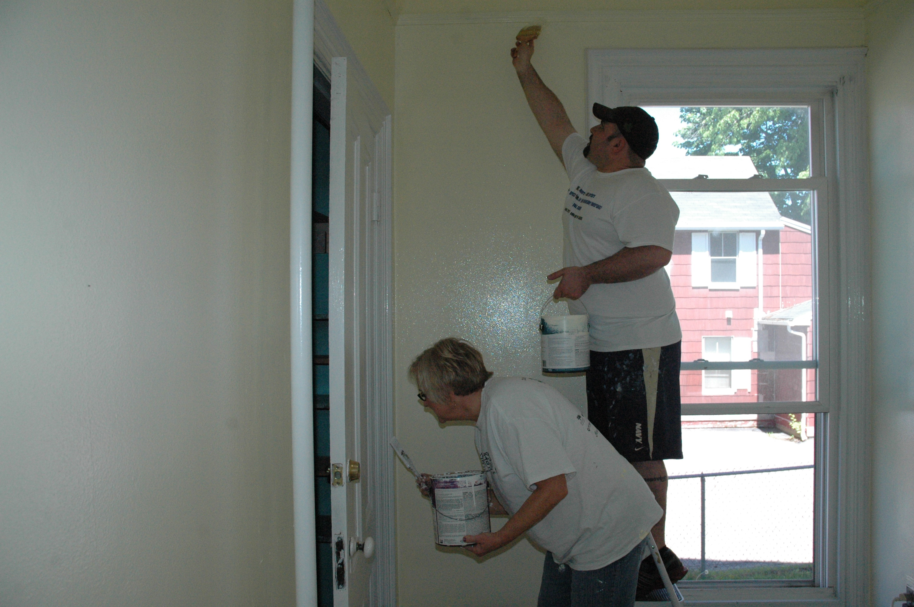 LIZ GOTTHELF/Journal TribuneJoyce Haley and Nick Anagnostis paint a room at Esther Residence in Saco on Wednesday.