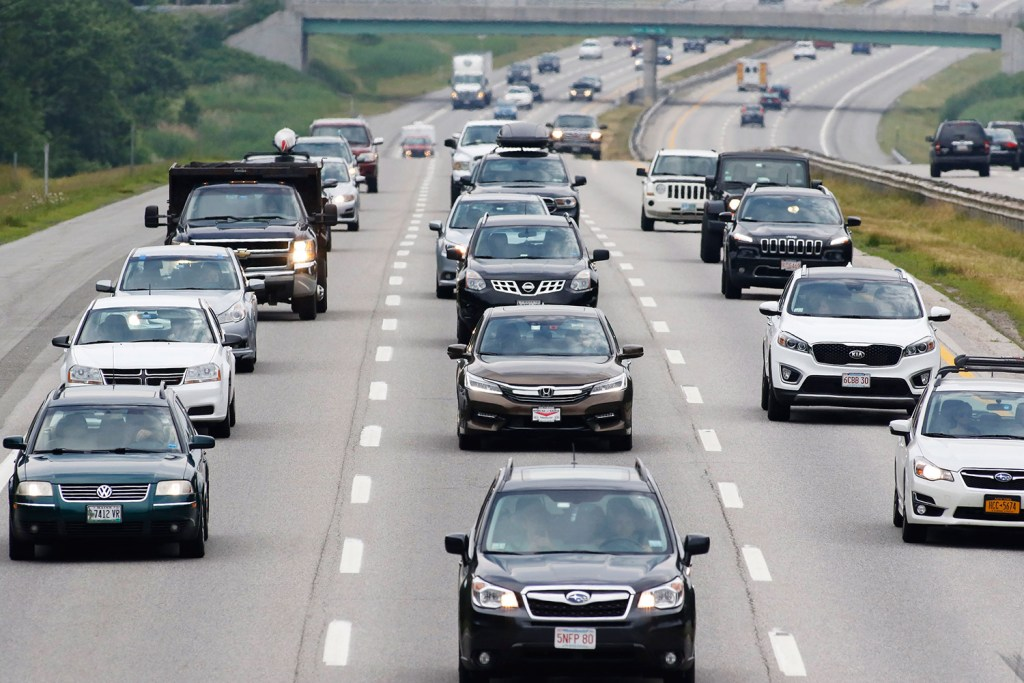 Holiday travelers hit the road heading north in Scarborough on Friday. A high volume of traffic is expected this July 4th.