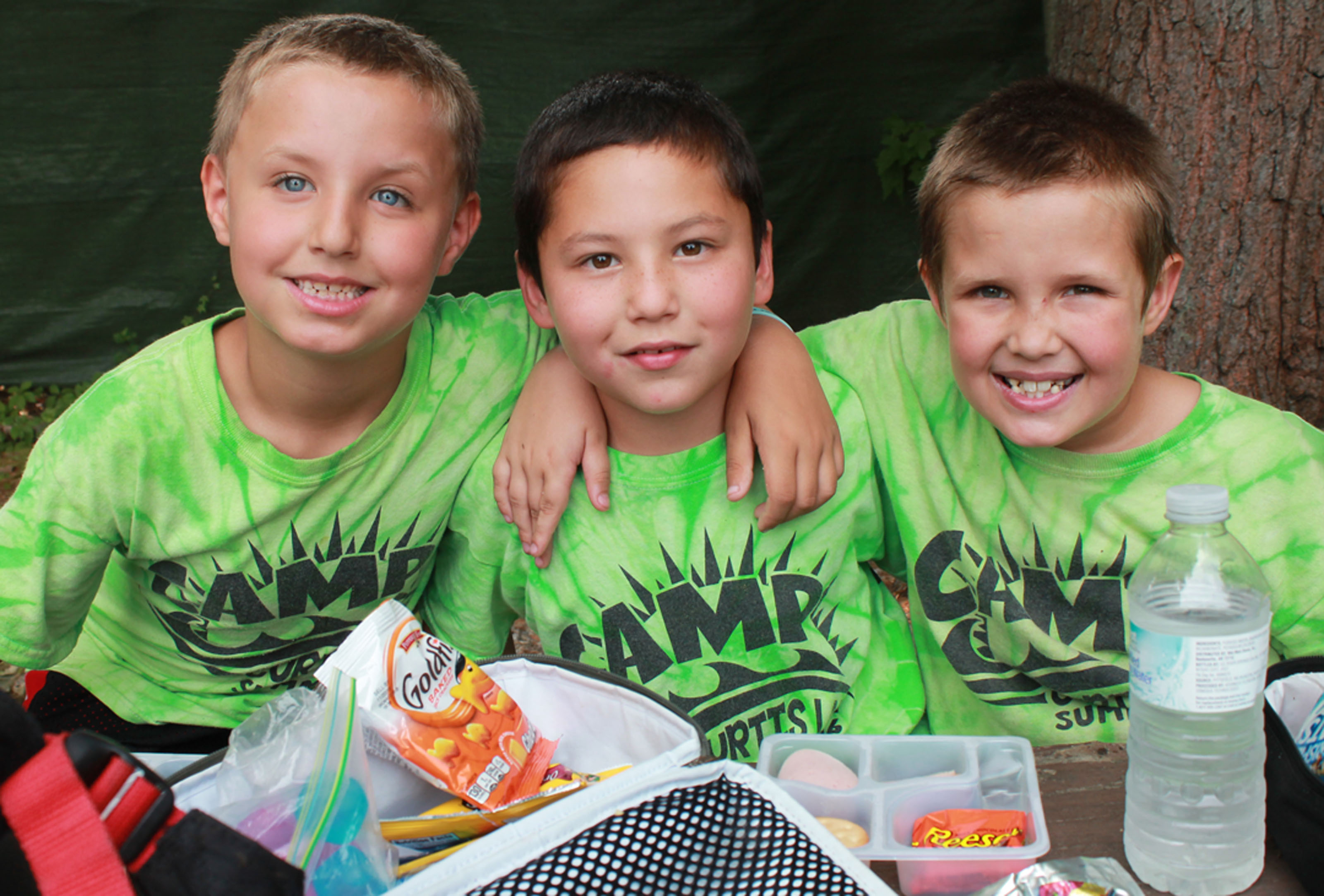 Campers smile while on a lunch break at Camp Curtis Lake in Sanford. COURTESY PHOTO/ Curtis Lake Church