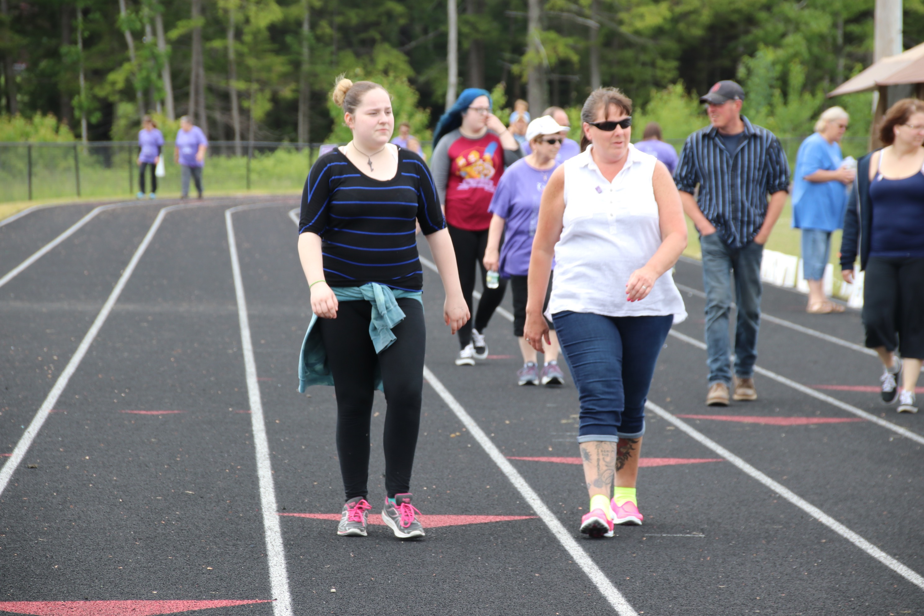 Ailia Haig left, and her aunt, Danielle Griffin, right, walk the track at Wells High School Saturday in the American Cancer Society's York County Relay for Life. They are walking for Danielle's husband Michael, who died of cancer in 2012. TAMMY WELLS/Journal Tribune