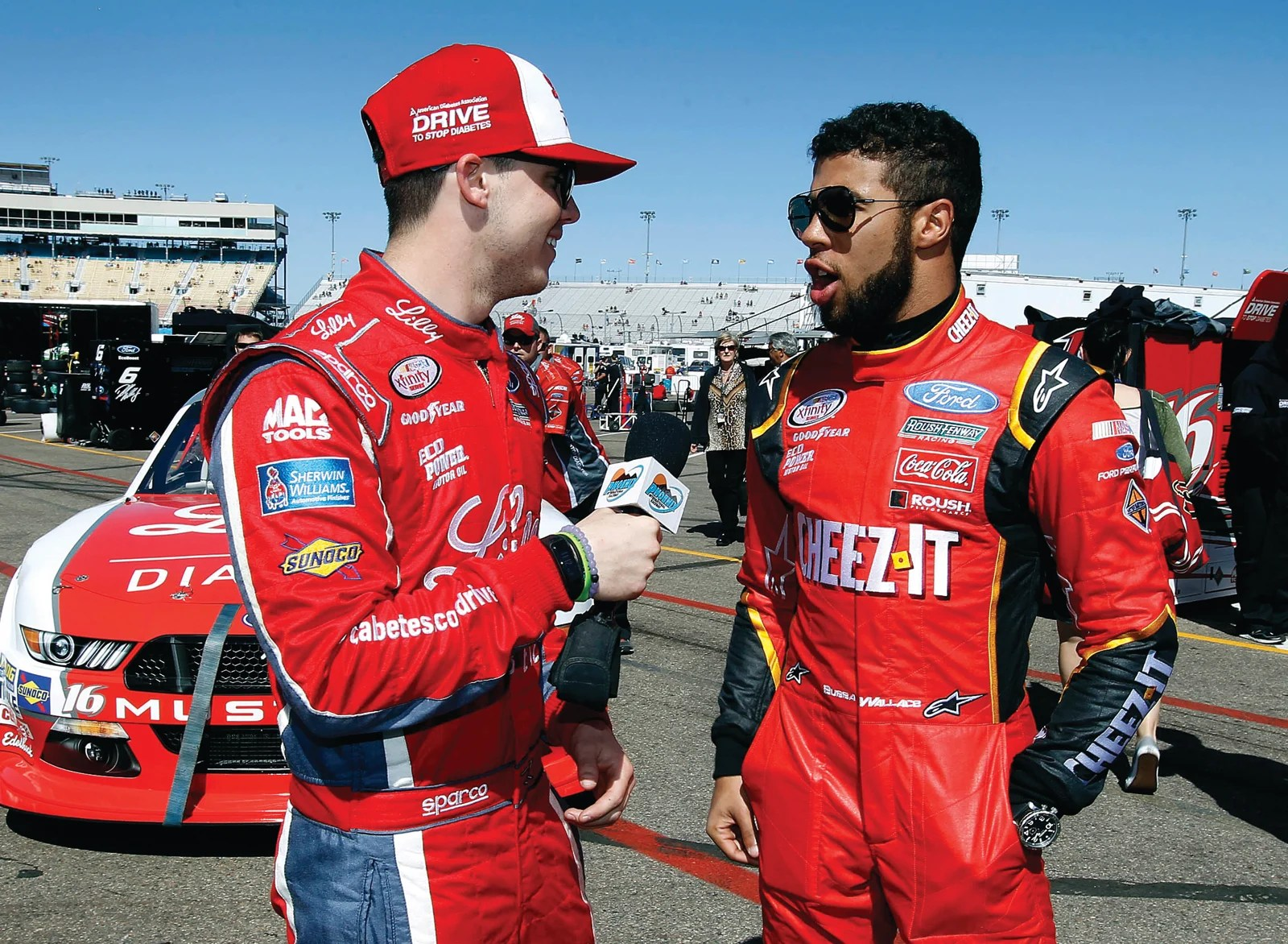 In this March 12, 2016, file photo, Ryan Reed, left, interviews fellow driver Darrell Wallace Jr. after NASCAR Xfinity Series qualifying at Phoenix International Raceway in Avondale, Ariz. Darrell Wallace Jr. will become the first black driver to race at NASCAR's top level since 2006 when he replaces injured Aric Almirola this weekend at Pocono Raceway. AP NEWSWIRE
