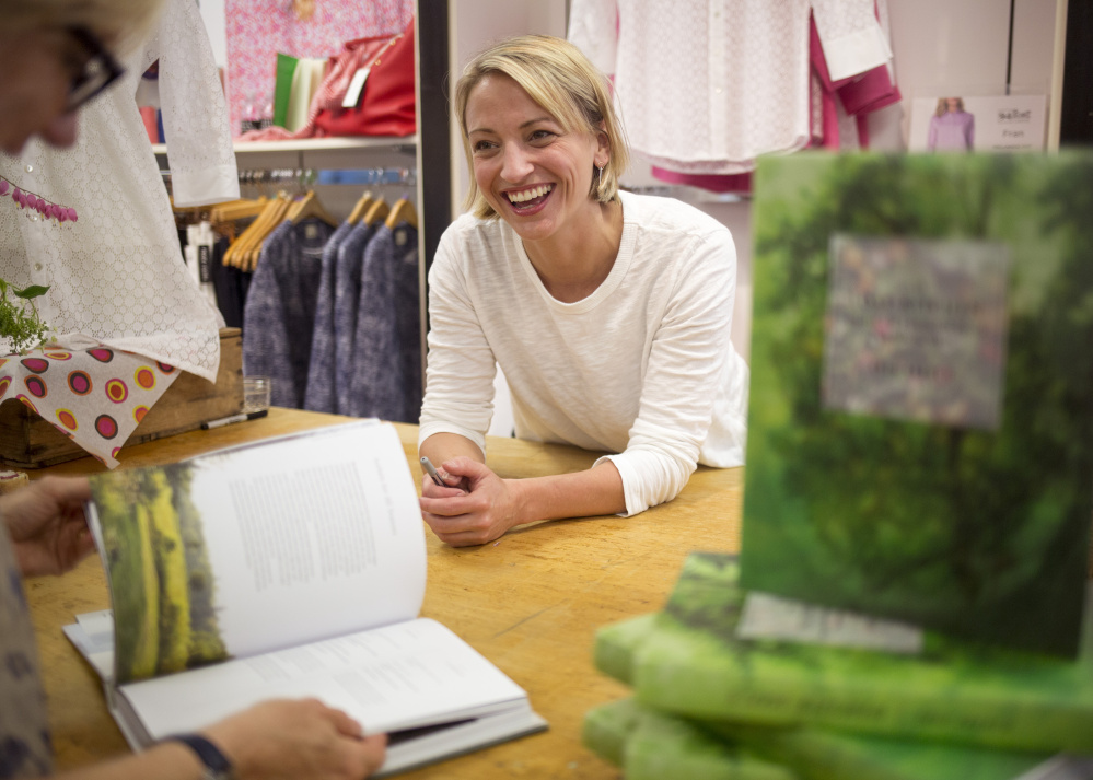 Erin French of the Lost Kitchen in Freedom talks with Susan Alexander of Falmouth at a book signing at the Jill McGowan store in 2017.