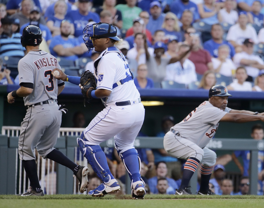 Royals catcher Salvador Perez tags Detroit's Ian Kinsler, who tried to score on a ball hit by Justin Upton in the first inning Monday in Kansas City, Mo.