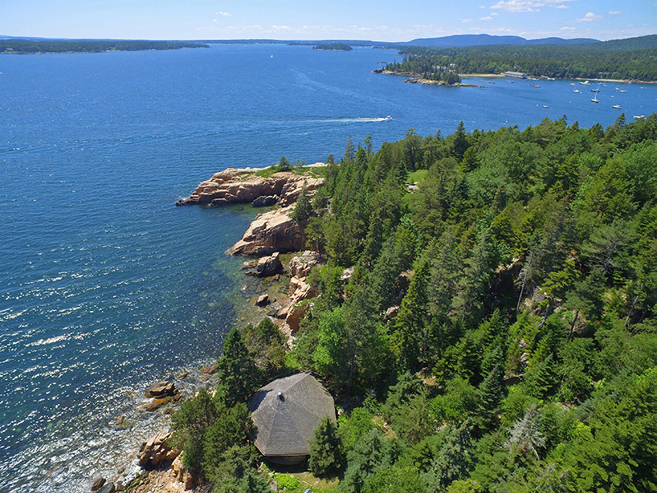 """The property sale includes the round """"study"""" along the cliff edge, center at bottom, where David Rockefeller wrote his memoirs, according to the listing agent, and there are granite outcroppings and almost a half-mile of shoreline."""
