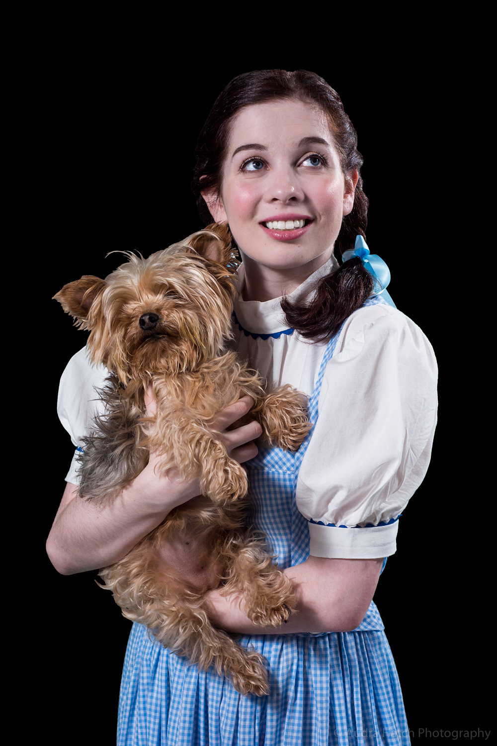 Brie Roche as Dorothy and Mo as Toto in City Theater's production of