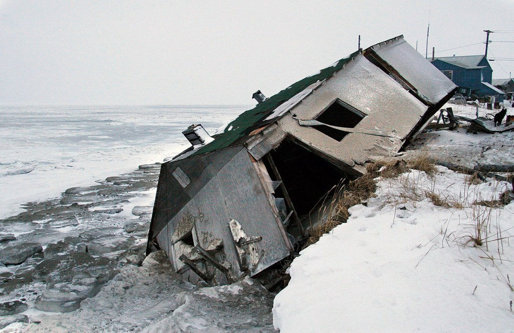 An abandoned house at the west end of Shishmaref, Alaska, sits on the beach after sliding off during a fall storm in 2005. Joel Clement, who worked with Alaskan communities affected by climate change, said residents need help funding expensive moves away from the encroaching water.
