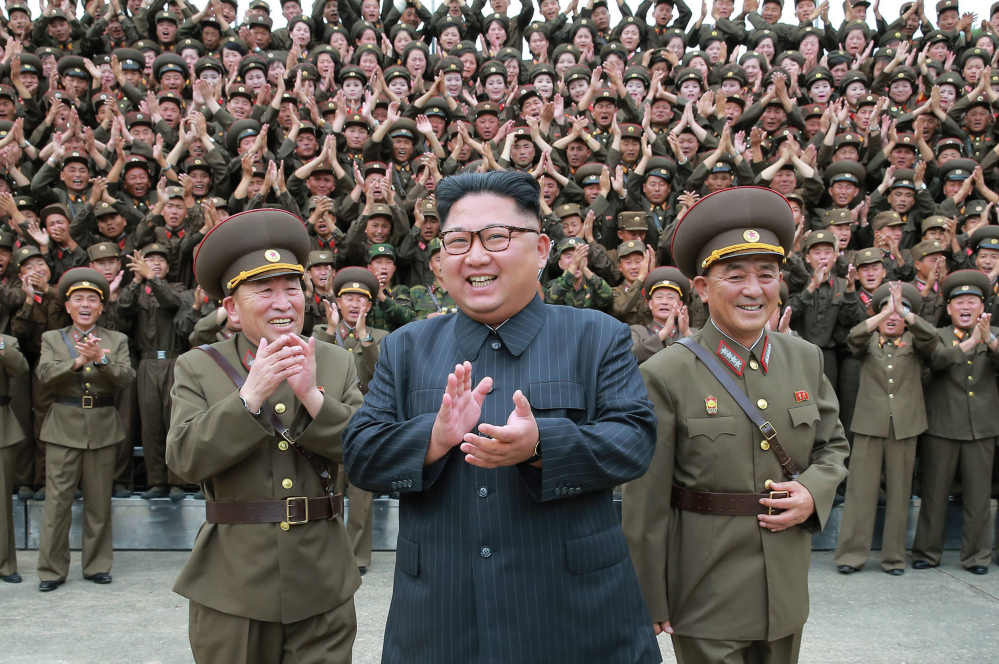 "Kim Jong Un acknowledges a welcome from the military officers during his visit to Korean People's Army's Strategic Forces in North Korea. Kim said he will give the order for a missile test near Guam if the United States continues its ""extremely dangerous actions"" on the Korean Peninsula."