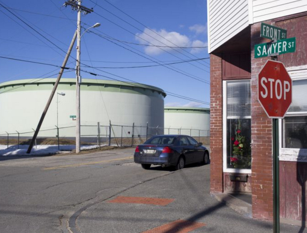 "At right, a Portland Pipe Line Corp. tank in South Portland. A judge said Friday that the firm's ""only alternative to shutting down its pipelines is to attempt to use them in a different way."" The city's motion to have the case dismissed was denied Friday."