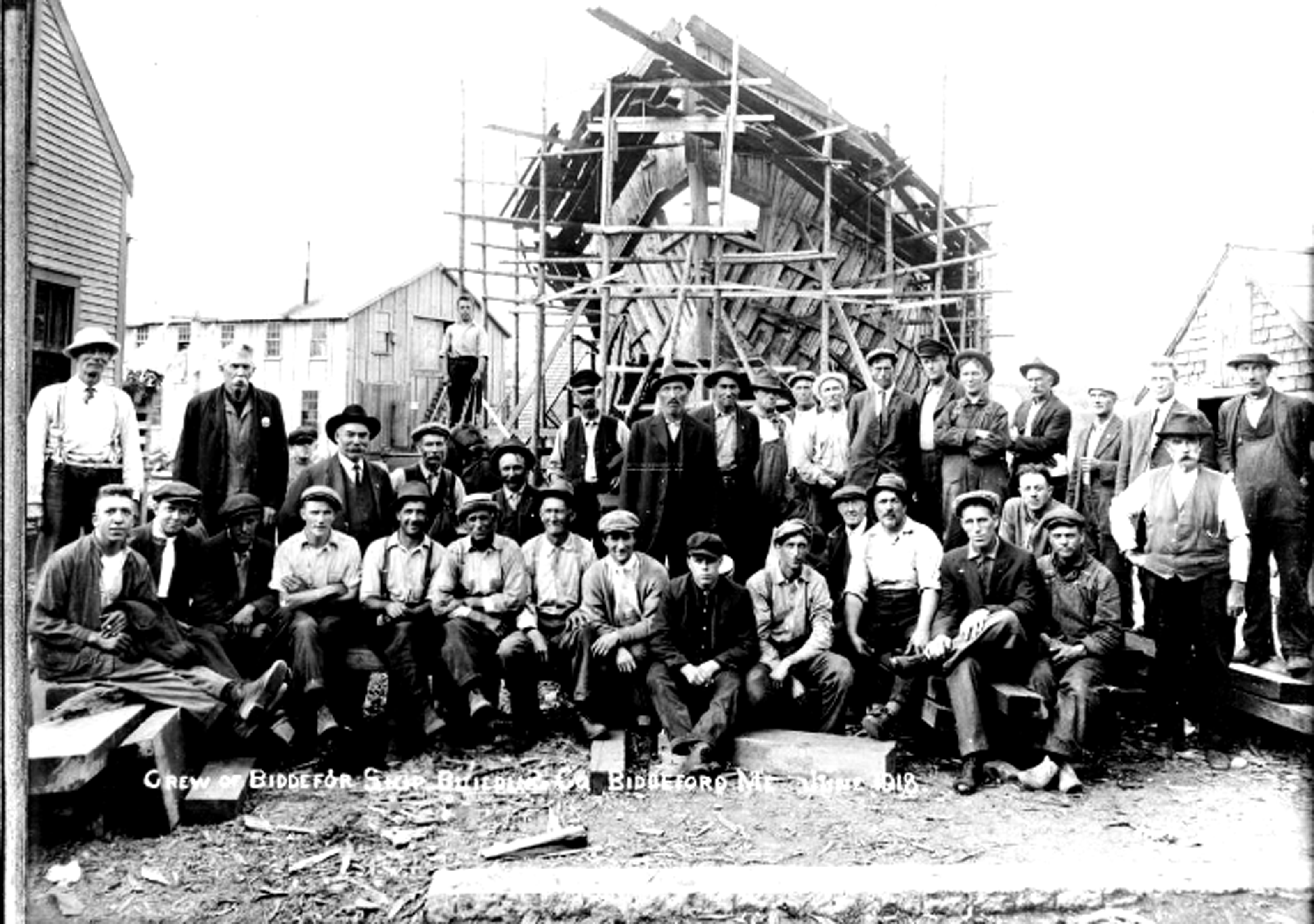 The crew of the Biddeford Shipbuilding Company gathers near the final ship produced by the business, the Jere G. Shaw, in Biddeford in 1918. COURTESY PHOTO/McArthur Public Library