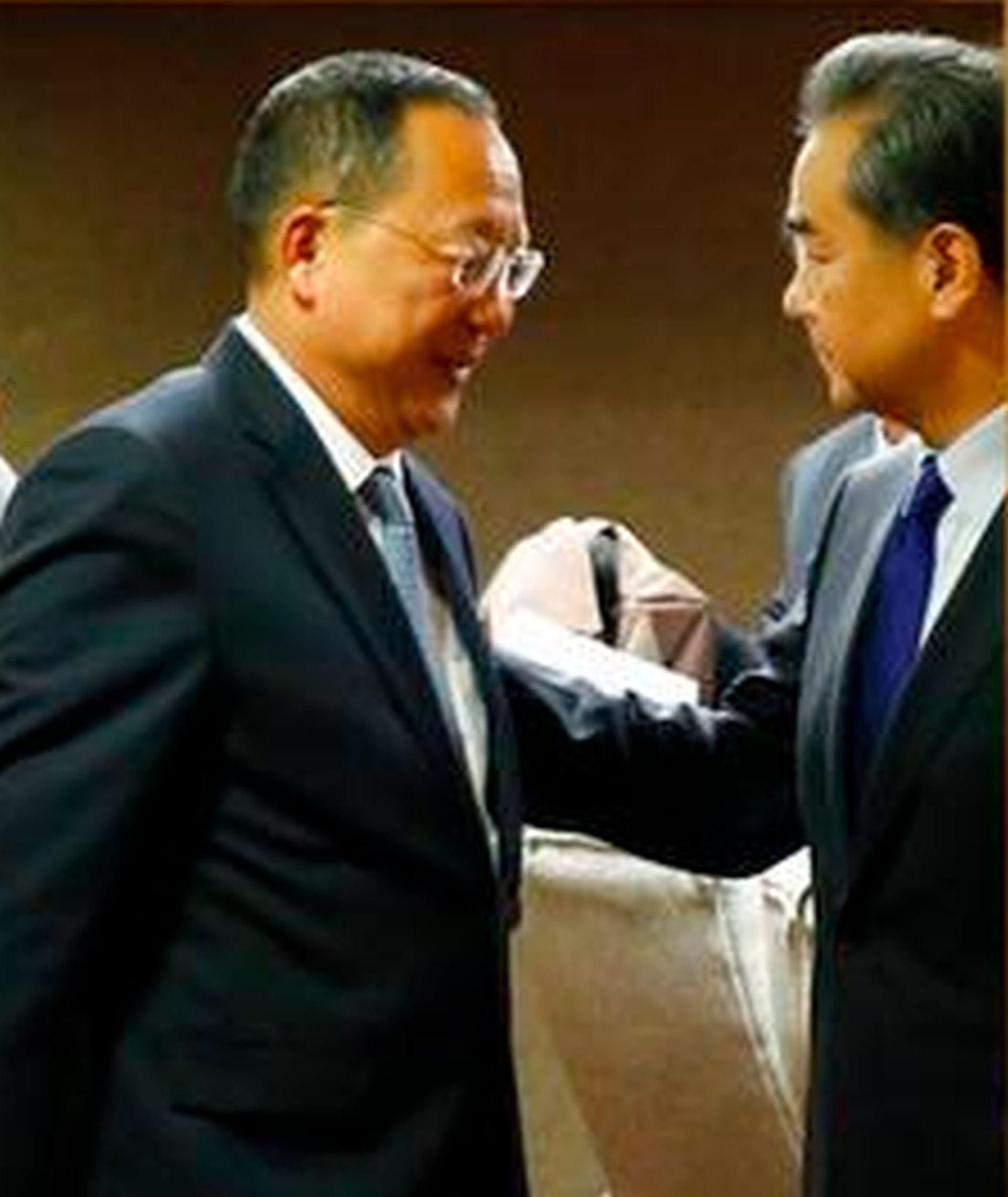 North Korean Foreign Minister Ri Yong Ho, center, bids farewell to his Chinese counterpart Wang Yi, right, following their bilateral meeting in the sidelines of the 50th ASEAN Foreign Ministers' Meeting and its Dialogue Partners Sunday, Aug. 6, 2017 in suburban Pasay city, south Manila, Philippines. AP WIREPHOTO/Bullit Marquez)